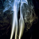 Colorful smoke on a dark background Royalty Free Stock Images