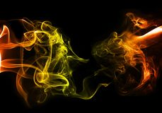 Colorful smoke. Fire theme on black buckground Royalty Free Stock Photo