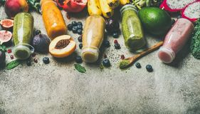 Colorful smoothies in bottles with fresh fruit, copy space Stock Images