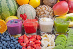 Colorful smoothies. And fresh fruits royalty free stock photography