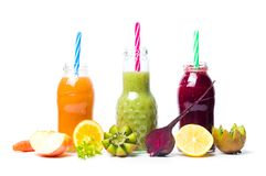 Colorful smoothies with fruits isolated Stock Images