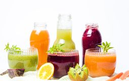 Colorful smoothies with fruits isolated Stock Photos