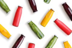 Colorful smoothies in glass bottles. Isolated on white background, top view royalty free stock photos