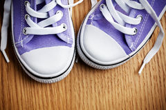 Colorful sneakers on wooden floor Royalty Free Stock Photo