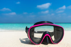 Colorful snorkel mask by the sea, remote tropical beaches. Trave Stock Image