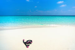Colorful snorkel mask by the sea, remote tropical beaches. Trave Royalty Free Stock Photography