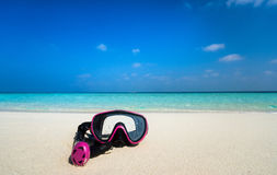 Colorful snorkel mask by the sea, remote tropical beaches. Trave Stock Photography