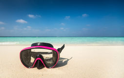 Colorful snorkel mask by the sea, remote tropical beaches. Trave Stock Images