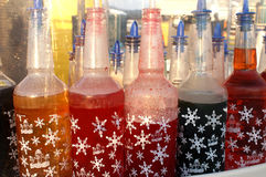 Colorful Snow Cone Flavors. Colorful bottles with different flavoring for icy snow cones Royalty Free Stock Image