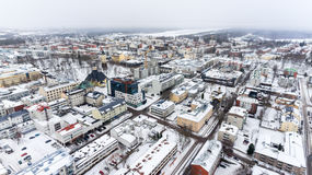 Colorful snowy roofs of houses of Lappeenranta city. Snow covered streets and roads. Finland, Europe. Aerial view Stock Images