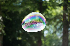Colorful soap bubble in the air. Highly reflective colorful soap bubble floating in the air Royalty Free Stock Images