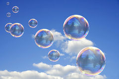Colorful Soap Bubbles. Against Blue Sky Background Stock Photography