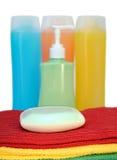 Soap, shampoo, and towel Stock Photos
