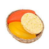 Colorful soap and sponge in a woven basket Stock Image