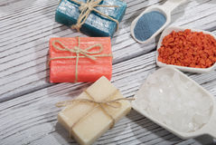 Colorful soaps. Colorful natural herbal soaps on wooden background Stock Photo
