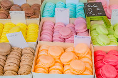 Colorful soaps shaped as macarons in boxes Stock Images