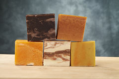 Colorful soaps. On a wooden table Stock Images
