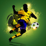 Colorful soccer player shooting. Silhouette soccer player shooting on a colorful abstract background Royalty Free Stock Images