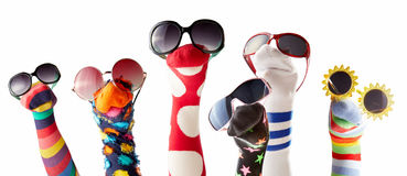 Sock puppets with glasses against white background. Colorful sock puppets with glasses isolated against white background royalty free stock images
