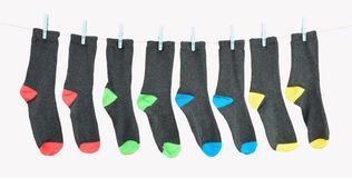 Colorful socks. Four pairs of colorful socks on a clothes line Royalty Free Stock Photo