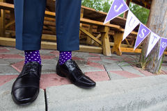 Colorful socks of groom. Closeup Stock Photos