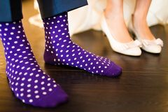 Colorful socks of groom. And the bride shoe Royalty Free Stock Image