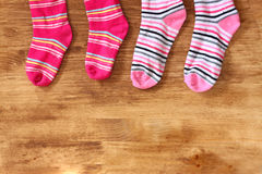 Colorful socks hanging against a wooden background Royalty Free Stock Photo
