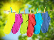 Colorful socks hanging from a rope Royalty Free Stock Photos