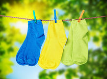 Colorful socks hanging from a rope Stock Images