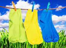 Colorful socks hanging from a rope Royalty Free Stock Image