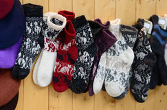 Colorful Socks hanging on wooden wall. Colorful warm socks hanging on wooden wall, winter clothes stock photography