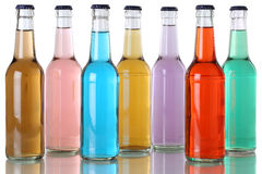 Colorful soda drinks with cola in bottles Stock Image