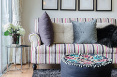Colorful sofa with pillows and glass table in living room Royalty Free Stock Photos