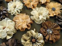 Beautiful fabric flowers - brooch on brown background Stock Images
