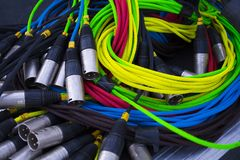 Colorful sound and light signal cables on black stage case, shallow focus.  royalty free stock images