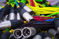 Colorful sound and light signal cables on black stage case, shallow focus.  stock photography