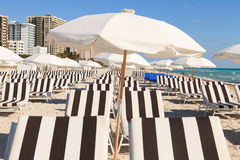 Colorful South Beach Umbrellas and Lounge Chairs Stock Photo