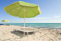 Colorful South Beach Umbrellas and Lounge Chairs Royalty Free Stock Photography