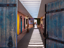 Colorful Southwestern style outdoor corridor. Gates opening to a colorful Southwestern style outdoor corridor Royalty Free Stock Photography