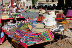 Colorful souvenir market in South America. Different colour sheets, traditional quechua clothes and bags sold on the street Royalty Free Stock Image