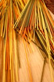 Colorful spaghetti on wooden background royalty free stock photo