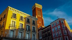 Colorful Spanish tower basking in the evening sun stock photos