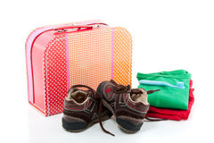 A colorful spare suitcase  with shoes Royalty Free Stock Photos