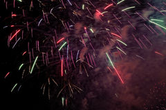Colorful sparks in night sky Royalty Free Stock Photos