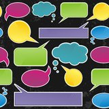 Colorful speech bubbles on dark seamless pattern Stock Photos