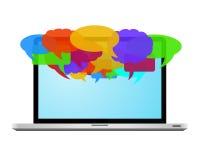 Colorful speech bubbles on laptop Stock Photos