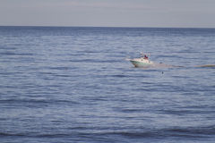 Colorful Speedboat on a Vast Blue Sea Royalty Free Stock Image