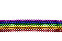 Colorful spheres magnet in rainbow line on a white backdrop Royalty Free Stock Photography