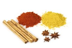 Colorful Spices. Various colorful spices from above isolated over a white background royalty free stock images