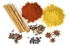 Colorful Spices. Various colorful spices from above isolated over a white background stock image
